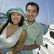 Couple smiling at marina — Stock Photo