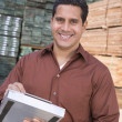 Stock Photo: Supervisor stock taking in warehouse