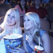 Friends watching film in movie theater — Stock Photo