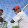 Baseball players at batting practice — Stock Photo