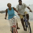 Couple cycling on beach — Stock Photo #33802285