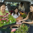 Stock Photo: Family Loading New Plants