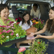 Family Loading New Plants — Stock Photo