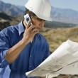 Construction worker using mobile phone — Stock Photo
