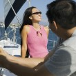 Man and woman on sailboat — Stock Photo