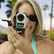 Woman holding camcorder — Stock Photo