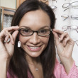 Woman trying on eyeglasses — Stock Photo