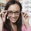 Stock Photo: Womtrying on eyeglasses