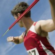 Постер, плакат: Male athlete about to throw javelin