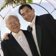 Groom with father under archway — Stock Photo #33803499