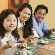 Stock Photo: Family Eating Sushi Together