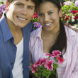 Couple Sitting Among flowers — Stock Photo