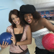 Friends with balls in bowling alley — Stock Photo #33803791