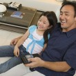 Father and Daughter Watching TV Together — Stock Photo