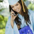 Graduate Using Cell Phone — Stock Photo