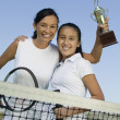 Mother and daughter holding trophy  — ストック写真