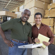 Warehouse workers stocktaking — Stock Photo