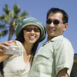 Stock Photo: Couple photographing themselves