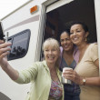 Ladies in RV Using Camera Phone — Stok fotoğraf