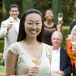 Friends toasting outdoors — Stock Photo
