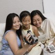 Mother and Daughters with Video Camera — Stock Photo