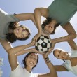 Women holding soccer ball — Stock Photo #33804669