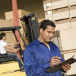 Supervisor and forklift truck driver — Stock Photo