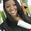 Graduate with Diploma — Stock Photo #33804807