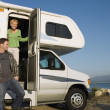 Stock Photo: Couple in RV at lakeshore