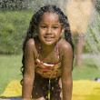 Girl Sliding on water slide — Stock Photo