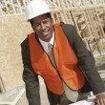 Surveyor with blueprints — Stock Photo