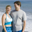 Couple standing on beach — Stock Photo