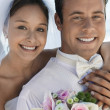 Bride and Groom with bouquet  — Stock Photo