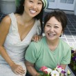Mother and daughter with flowers — Stock Photo