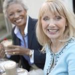 Smiling Women Having Coffee Drinks — Stock Photo #33805673