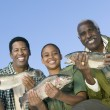 Family showing fishes — Stock Photo #33806001