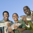 Family showing fishes — Stock Photo