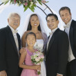 Bride and Groom with best man and family — Stock Photo