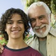 Boy with Grandfather — Stock Photo #33806047