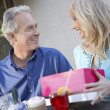 Couple sitting at cafe table — Stock Photo #33806075
