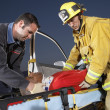 Fire fighter and paramedics — Stock Photo
