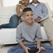 Parents Watching Son Play Video Games — Stock Photo
