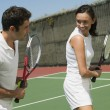 Foto Stock: Tennis Player Getting Instruction