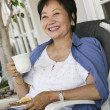 Asian Woman Drinking Tea — Stock Photo