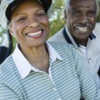 Senior couple in golf course — Stock Photo