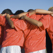 Soccer team in huddle — Stock Photo #33806501