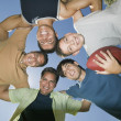 Men in a Football Huddle — Stock Photo