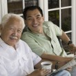 Father and son sitting — Stockfoto