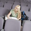 Student writing in lecture hall — Stock Photo #33807005