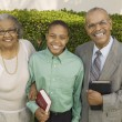 Christian Grandparents and Grandson — Stock Photo